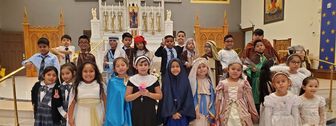 students in costume on altar