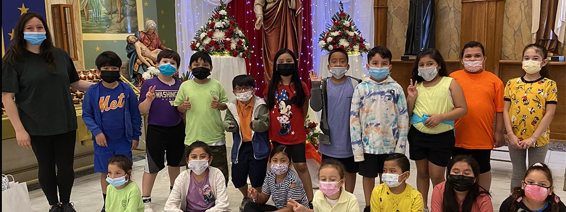 students at end of year mass 2021