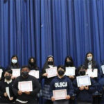 students with awards at assembly